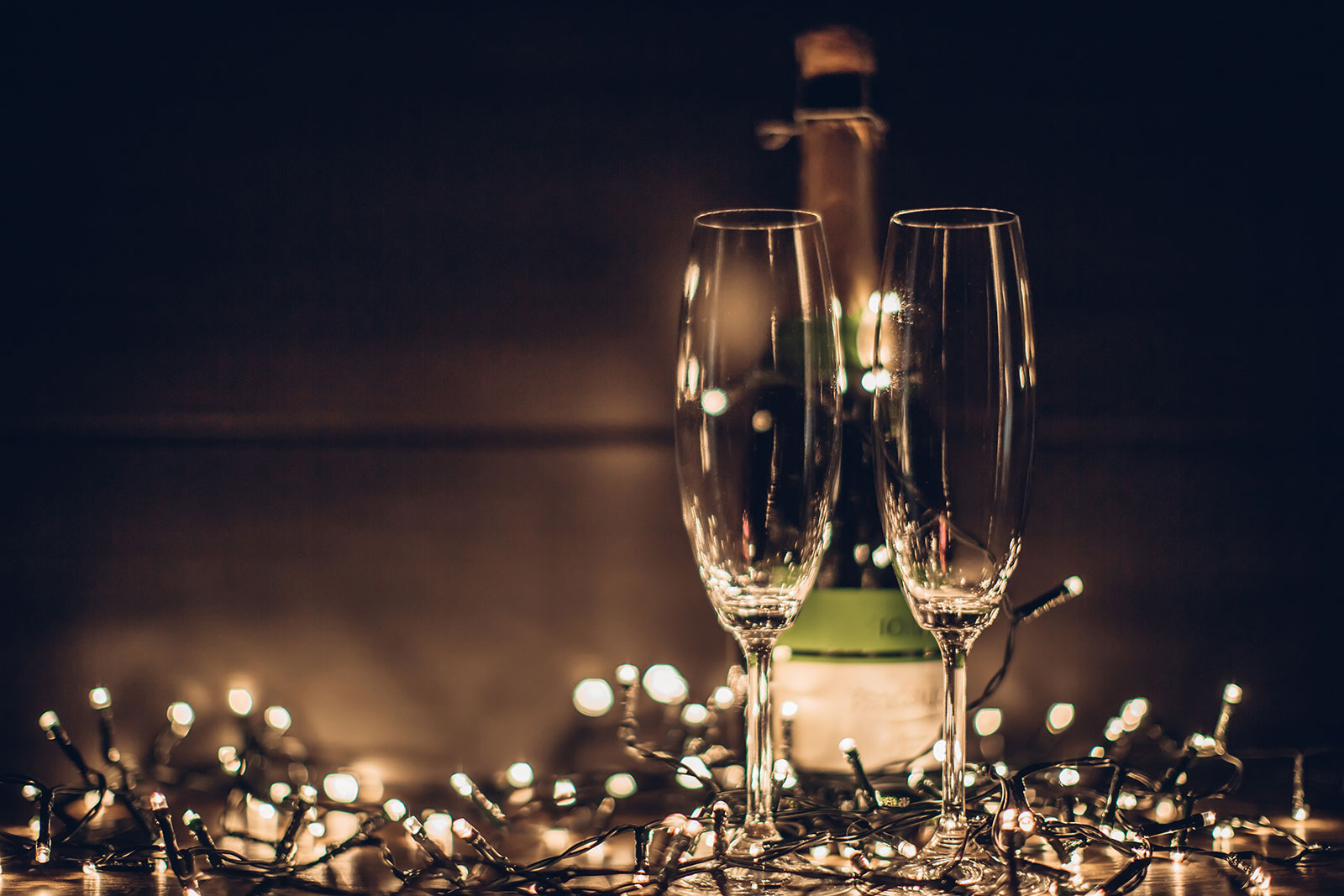 Two champagne glasses with fairy lights