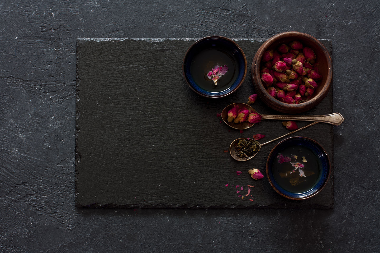 Indian flowers in bowls on slate