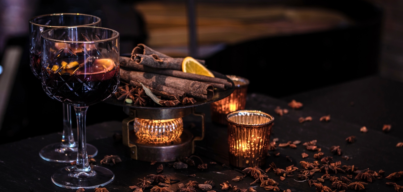 Mulled wine with cinnamon and candles